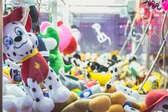 Claw machine allows to win stuffed animals. SABLES D OLONNE, FRANCE - November 27, 2016: In a traditional funfair a claw machine allows to win stuffed animals Stock Photos