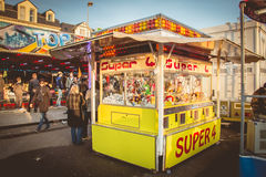 Claw machine allows to win stuffed animals. SABLES D OLONNE, FRANCE - November 27, 2016: In a traditional funfair a claw machine allows to win stuffed animals Stock Image