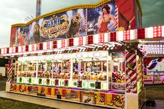 Claw Machine Booth. WETZLAR, GERMANY JULY 2017: A claw crane game machine at an traditional amusement park called Ochsenfest in Wetzlar. The prizes are famed Stock Photos