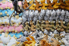 Claw Machine - Soft Toys. Various animal soft toys inside the glass container with the electronic claw top left corner. At an arcade entertainment center Stock Images
