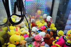 Claw vending machine. With toys royalty free stock photos