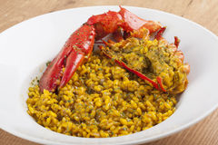 Clawed Lobster with yellow rice Royalty Free Stock Photos