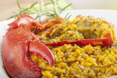 Clawed Lobster with yellow rice Stock Image