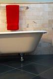 Clawfoot tub in bathroom. Clawfoot bathtub inn bathroom with slate and limestone tile surround Royalty Free Stock Photography