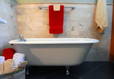 Clawfoot tub in bathroom. Spa setting. Old fashion clawfoot tub in bathroom with slate and limestone tile surround Stock Images