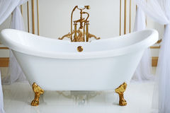 Clawfoot tub. White Bathroom in romantic style Stock Photography