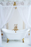 Clawfoot tub. White Bathroom in romantic style Royalty Free Stock Photo
