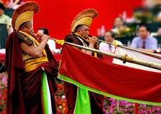 Claxon largo del soplo tibetano del lama Fotos de archivo libres de regalías