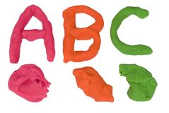 Clay alphebet letters. Creating alphabet letters with clay in bright colors Stock Photography