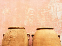 Clay amphoras near an old wall Stock Photos