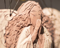 Clay angel praying macro Stock Images