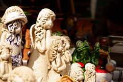 Clay angels and frogs at the fair of artisans in Riga Stock Photo