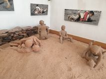 Sand, Clay art, Leaf, Tribal art  Nice, Colorful, Combination , Unique, Image. This is clay art  Showing Wrestling game to Village children`s in the sand ,Bhopal royalty free stock image