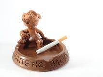 Clay ashtray with the man Royalty Free Stock Photos