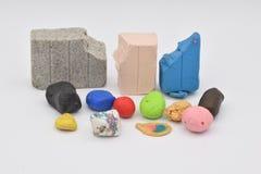 Clay Bits colorido en blanco foto de archivo libre de regalías
