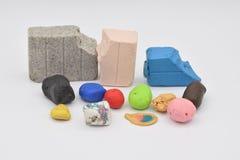 Clay Bits colorido en blanco imagen de archivo libre de regalías