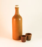 Clay bottle of a wine and cups Royalty Free Stock Images