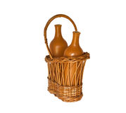 Clay bottles  in a basket Stock Images