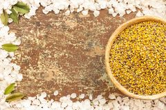Clay bowl with bee pollen royalty free stock image