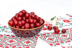 Clay bowl with cherry Royalty Free Stock Images