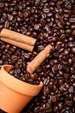 Clay bowl with coffee beans and cinnamon Stock Photo
