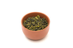 Clay bowl with dry leaves of tea Stock Photography