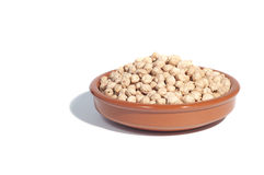 Clay bowl filled with chickpeas,  Stock Photography
