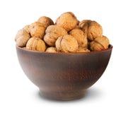 Clay Bowl Full Of Walnuts Immagini Stock