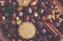 Clay bowl with gingerbread cookies, spices, nuts and sugar Royalty Free Stock Image