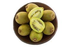 Clay bowl of golden yellow mini kiwi berry fruit isolated on whi Royalty Free Stock Photo
