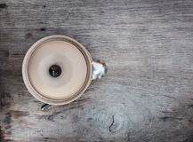 Clay bowl with lid on a wooden table Royalty Free Stock Photography
