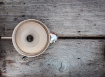 Clay bowl with lid on a wooden table Stock Photo