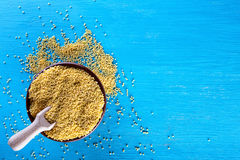 Clay bowl with millet on a blue background. View from above. The concept of healthy natural food Royalty Free Stock Image