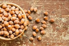 Clay bowl with nuts royalty free stock images