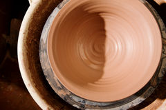 Clay bowl on potters wheel Royalty Free Stock Image