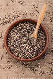 Clay bowl with white, black and red quinoa Stock Photos