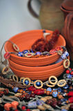 Clay bowls and ceramic beads Royalty Free Stock Photos