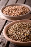 Clay bowls with lentils and chickpeas on wooden board Stock Photo