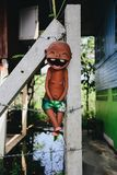 Clay boy laugh. Colorful of the Boy  laugh statue on the fence Stock Image