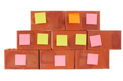 Clay bricks and pasted stickers Royalty Free Stock Images