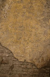 Clay brown wall of the old house. Textured background Stock Images