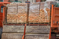 Clay building bricks delivered to the job site in pallets Royalty Free Stock Photography
