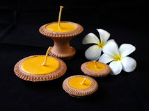 Clay candle set with the plumeria flower Royalty Free Stock Images
