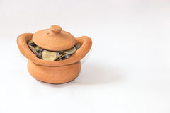 Clay casket full of coins for economy concept Stock Images