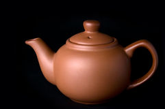 Clay (ceramic) teapot on dark Stock Photo