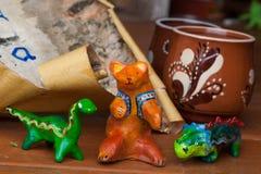 Clay ceramic toy bear dinosaur still life beautiful cute kids Royalty Free Stock Photo