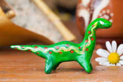 Clay ceramic toy dinosaur still life beautiful cute kids long neck Royalty Free Stock Image
