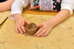 Clay in child hands Stock Photography