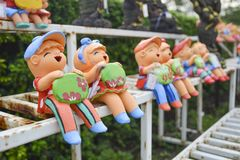 Clay children holding sign boards. After raining Royalty Free Stock Photography