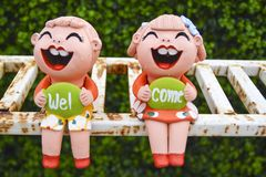 Clay children holding sign board after raining. Clay children holding `Welcome` sign board after raining Royalty Free Stock Photography